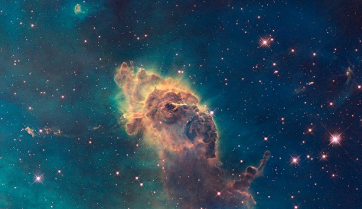 Jet in Carina Composed of gas and dust, the pillar resides in a tempestuous stellar nursery called the Carina Nebula, located 7,500 light-years away in the southern constellation Carina. Scorching radiation and fast winds (streams of charged particles) from nearby stars are sculpting the pillar and causing new stars to form within it. Streamers of gas and dust can be seen flowing off the top of the structure.