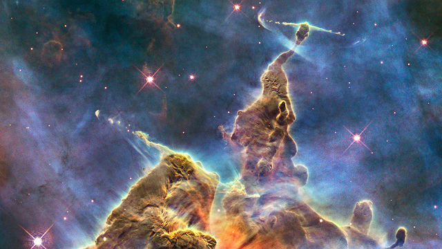 Mystic Mountain Mystic Mountain, released for Hubble's 20th anniversary, reveals a landscape never before studied in such detail. These pillars show the telltale signature of new stars forming at their tips and strong jets of material being ejected into the interstellar medium for great distances. Many such features are seen in the Carina Nebula, a vast area of dust and gas in our Milky Way Galaxy. This is the most obvious and spectacular example, similar to others in an immense Hubble mosaic made a few years before.