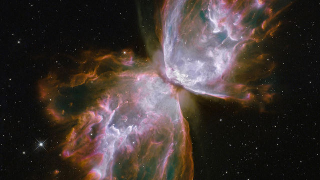Butterfly Nebula, NGC 6302 What resemble dainty butterfly wings are actually roiling cauldrons of gas heated to more than 36,000 degrees Fahrenheit. The gas is tearing across space at more than 600,000 miles an hour—fast enough to travel from Earth to the Moon in 24 minutes. A dying star is at the center of this fury. It has ejected its envelope of gases and is now unleashing a stream of ultraviolet radiation that is making the cast-off material glow.
