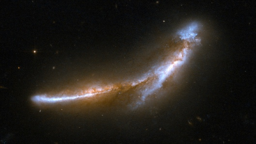 NGC 6670 NGC 6670 is a gorgeous pair of overlapping edge-on galaxies resembling a leaping dolphin. Scientists believe the galaxies of NGC 6670 have already experienced at least one close encounter and are now in the early stages of a second. The nuclei of the two galaxies are approximately 50,000 light-years apart. NGC 6670 glows in the infrared with more than a hundred billion times the luminosity of our Sun and is thought to be entering a starburst phase.