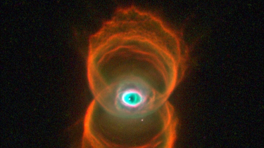 Hourglass Nebula This snapshot of MyCn18, a young planetary nebula, reveals that the object has an hourglass shape with an intricate pattern of