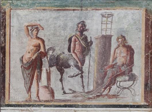 Τοιχογραφία του 1ου αι. μ.Χ.  η οποία φυλάσσεται στο αρχαιολογικό μουσείο της Νάπολι και απεικονίζει από αριστερά τους Απόλλωνα, Κένταυρο Χείρωνα και Ασκληπιό.