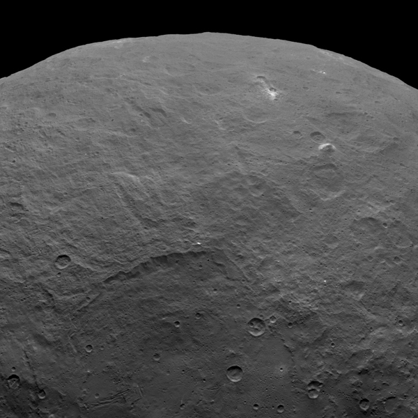 Among the fascinating features on dwarf planet Ceres is an intriguing pyramid-shaped mountain protruding from a relatively smooth area. Scientists estimate that this structure rises about 3 miles (5 kilometers) above the surface. NASA's Dawn spacecraft took this image from an altitude of 2,700 miles (4,400 kilometers). The image, with a resolution of 1,400 feet (410 meters) per pixel, was taken on June 6, 2015.