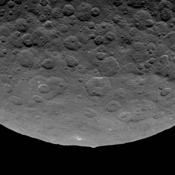 This image, taken by NASA's Dawn spacecraft, shows an intriguing mountain on dwarf planet Ceres protruding from a relatively smooth area. Scientists estimate that this structure rises about 3 miles (5 kilometers) above the surface. Dawn captured this image from an altitude of 2,700 miles (4,400 kilometers). The image, with a resolution of 1,400 feet (410 meters) per pixel, was taken on June 14, 2015.