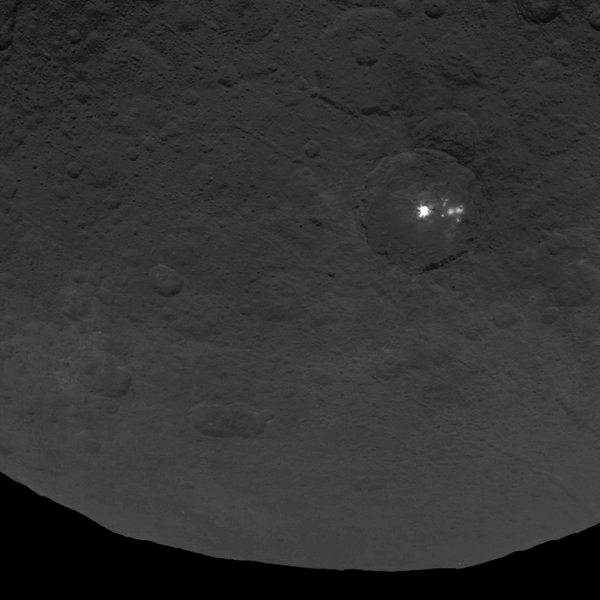 A cluster of mysterious bright spots on dwarf planet Ceres can be seen in this image, taken by NASA's Dawn spacecraft from an altitude of 2,700 miles (4,400 kilometers). The image, with a resolution of 1,400 feet (410 meters) per pixel, was taken on June 9, 2015.