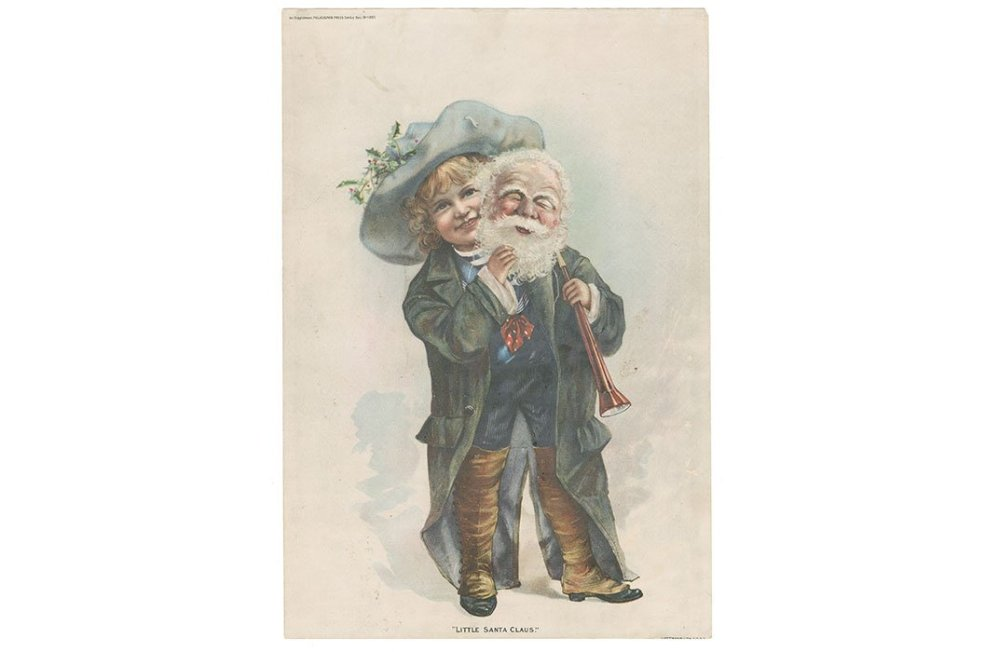 From 1887, a Victorian Era's little boy in blue peers mischievously from behind his Santa mask. (NMAH Archives Center, Warshaw Collection of Business Americana)