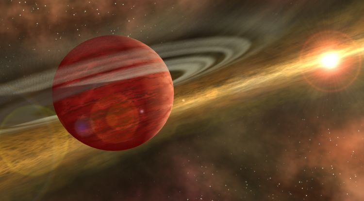 An artist's impression of a young gas giant planet still swathed in traces of a late-stage protoplanetary disk. Credit: NASA/JPL-Caltech)]