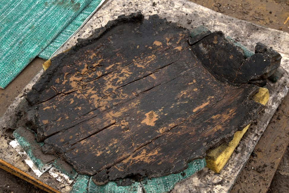 "A very well preserved wooden ""platter"" found recently. 34cm by 43cm © Cambridge Archaeological Unit_Historic England"